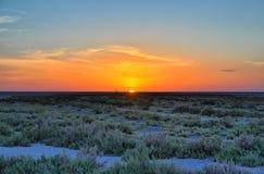 Beau coucher du soleil sur l'EL Djerid, désert du Sahara, TU de Chott de lac de sel Photographie stock
