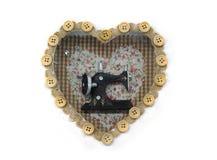 Beau décor sous forme de coeur avec un insid de machine à coudre Images libres de droits