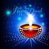 Beau diya de diwali dans le backgro bleu rougeoyant brillant de couleur Photographie stock libre de droits