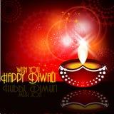 Beau diya de diwali dans le backgrou rougeoyant brillant de couleur rouge Image stock