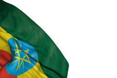 Beau drapeau de l'Ethiopie avec de grands plis se situant dans en bas à gauche le coin d'isolement sur blanc - toute illustration illustration stock