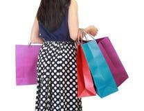 Beau femme avec beaucoup de sacs à provisions Image stock