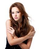 Beau femme avec de longs poils Image stock