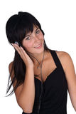 Beau femme avec des écouteurs Images stock