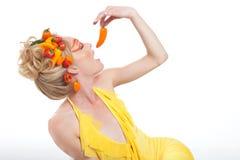 Beau femme avec des poivrons Image stock