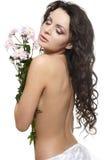 beau femme avec les fleurs colorées Image stock