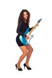 Beau femme d'affaires jouant la guitare électrique Photographie stock libre de droits