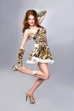 Beau femme dans le costume de tigre Photographie stock libre de droits