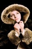 Beau femme dans le manteau de fourrure de l'hiver Image stock