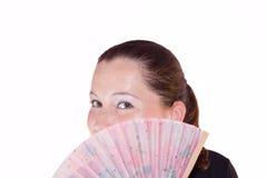 Beau femme derrière un ventilateur tenu dans la main Photos stock