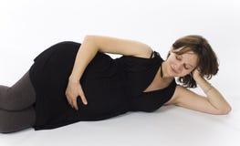 Beau femme enceinte dans la robe noire Photo libre de droits