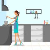 Beau femme faisant cuire dans la cuisine Photographie stock