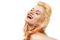 Beau femme riant avec les languettes rouges Photographie stock