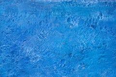 Beau fond foncé décoratif grunge abstrait de mur de stuc de bleu marine image stock