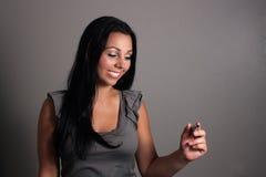 Beau jeune femme avec un repère (5) Image stock