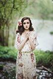 Beau jeune femme dans la forêt Images stock