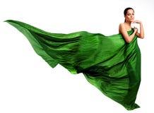 Beau jeune femme dans la robe verte Photos stock