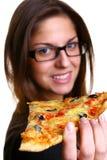 Beau jeune femme mangeant de la pizza Photo stock
