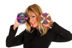 Beau jeune femme retenant le disque compact Photos libres de droits