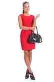 Beau jeune femme snob dans de hauts talons de robe rouge Photographie stock libre de droits