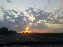 Beau lever de soleil sur la route Photographie stock