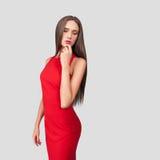 Beau modèle dans la robe rouge Photographie stock
