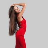 Beau modèle dans la robe rouge Images stock