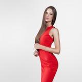 Beau modèle dans la robe rouge Photo stock