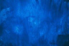Beau mur foncé décoratif grunge abstrait de stuc de bleu marine images stock