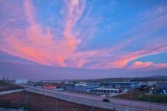 Beau nuage sur une usine Images libres de droits
