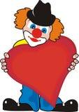 Beau petit clown amoureux avec le grand coeur Image libre de droits