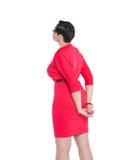Beau plus la femme de taille regardant sur quelque chose  Pose arrière Photos libres de droits