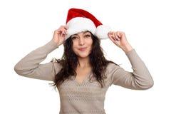 Beau portrait de fille habillé dans le chapeau de Santa Fond d'isolement par blanc Concept de vacances de soirée du Nouveau an et Photo libre de droits