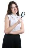 Beau portrait de fille regardant par la loupe D'isolement Image stock