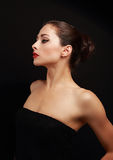 Beau profil sexy de femme sur le noir Images libres de droits