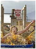 """Beau's Oktoberfest 2012. One festival goer is dunked in the """"Dunk Tank O' Beer"""" at Beau's forth annual Oktoberfest held at Vankleek Hill fairgrounds, Ottawa on Royalty Free Stock Photography"""