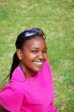 Beau sourire de femme de couleur Image libre de droits
