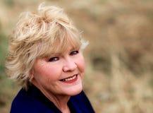Beau sourire mûr de femme Photographie stock libre de droits