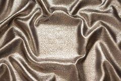 Beau tissu en bronze ondulé en soie brillant images stock