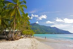 Beau Vallon beach 1. White sands beach of Beau Vallon bay, the most important tourism center of Mahe island, Seychelles, with palm trees and people  swimming in Royalty Free Stock Photo