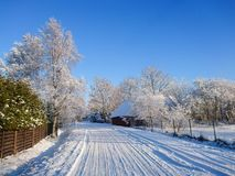 Beauatiful country road in snowy winter Stock Photography