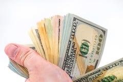 Beaucoup de billets de banque des dollars, d'isolement sur le blanc Images stock