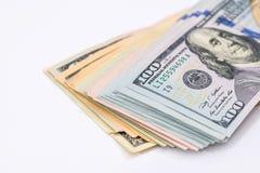 beaucoup de billets de banque des dollars, sur le blanc Image libre de droits