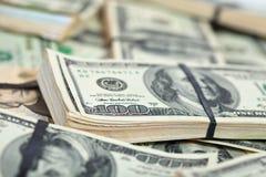 Beaucoup de billets de banque de dollars US Photographie stock libre de droits