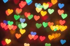 Beaucoup de coeurs multicolores rougeoyants Photographie stock libre de droits