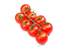 Beaucoup de des tomates rouges lumineuses organiques, juteuses, fraîches, saines, sur un fond blanc légumes Photos libres de droits