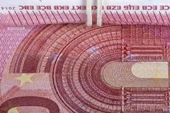 Beaucoup de dix euro factures de valeur enroulées photos libres de droits