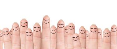 Beaucoup de doigts avec les visages tirés Images libres de droits