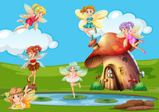 Beaucoup de fées volant au-dessus de l'étang Image stock