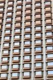 Beaucoup de fenêtres sur un bâtiment Image libre de droits